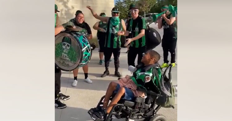 marching band playing for teen in wheelchair