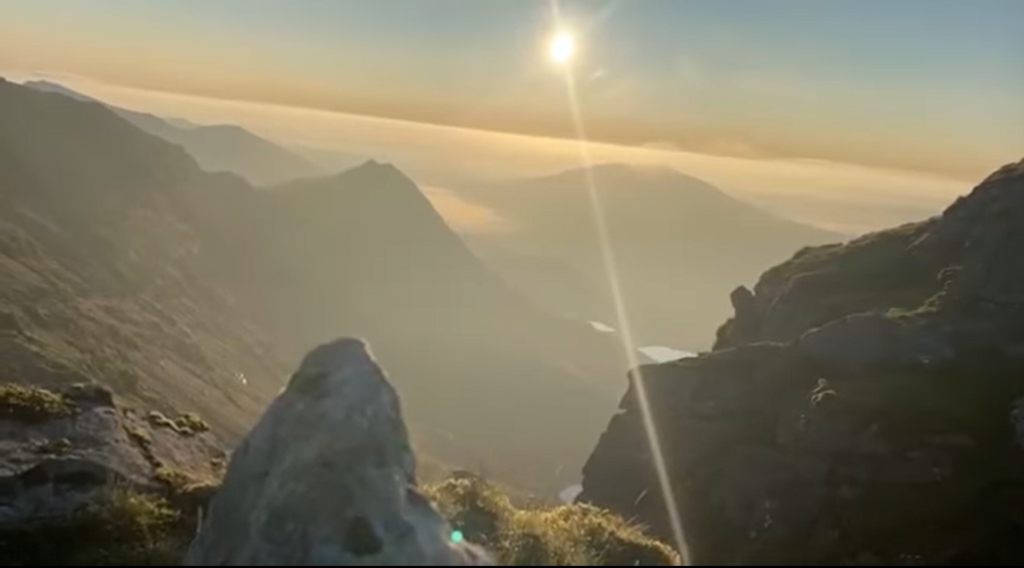 sunset on top of a mountain