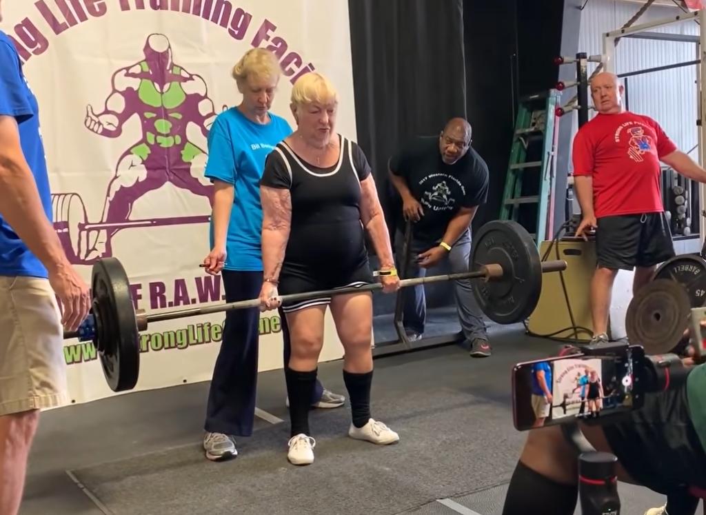 grandma lifting 150-pound weight bar