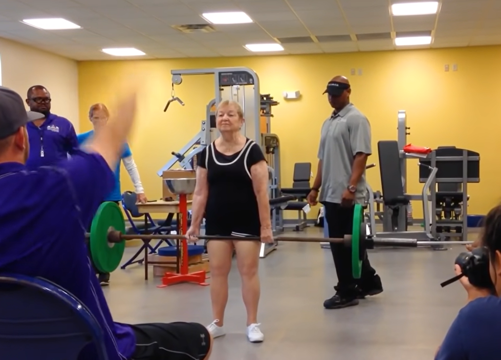100-year-old lifting weight bar in gym