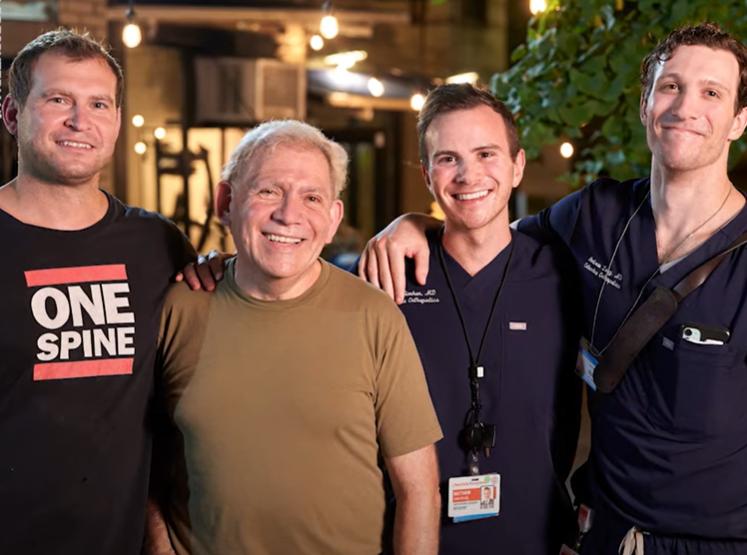 three doctors standing around smiling jazz musician