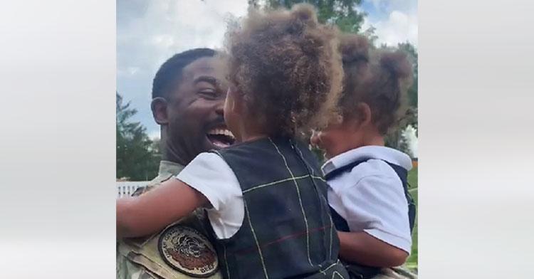 little girls hugging military dad