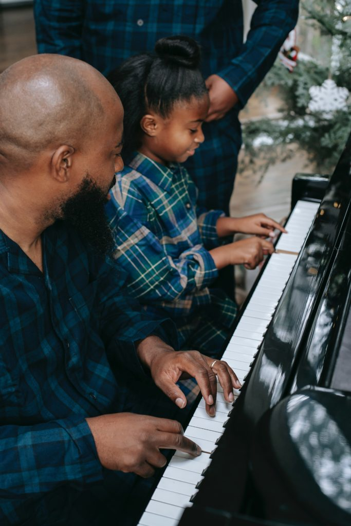 dad with daughter at piano