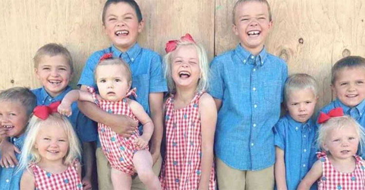 11 kids in matching red and blue outfits