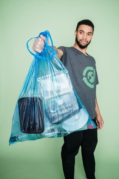 man holding trash bag