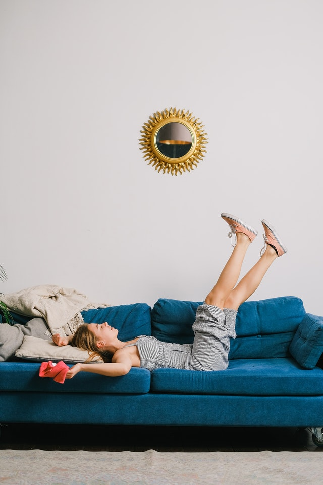 woman on clean blue couch