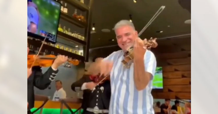 dad playing in restaurant mariachi band