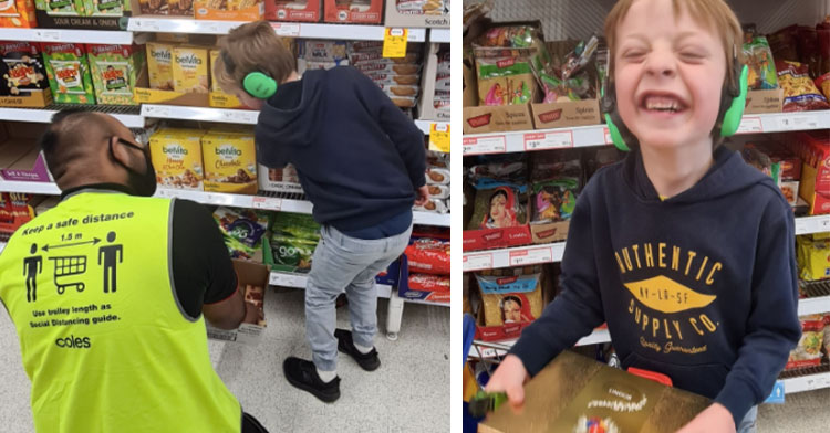 supermarket worker helping little boy next to little boy beaming holding box of chocolates