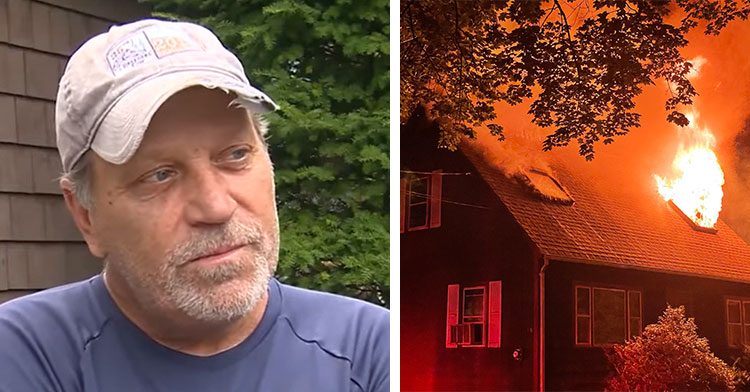 man standing in yard next to house on fire