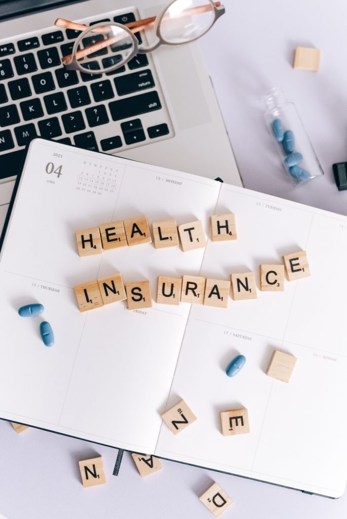 Scrabble tiles that spell out Health Insurance