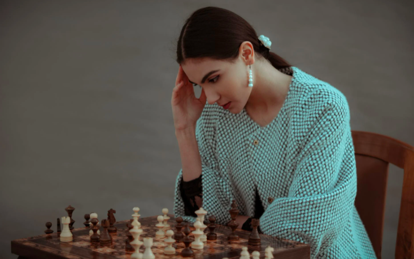 woman thinking about chess moves