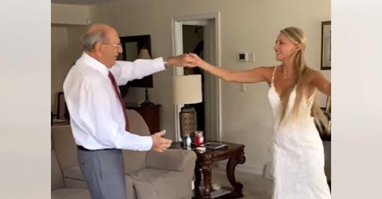 grandpa dancing with bride in living room