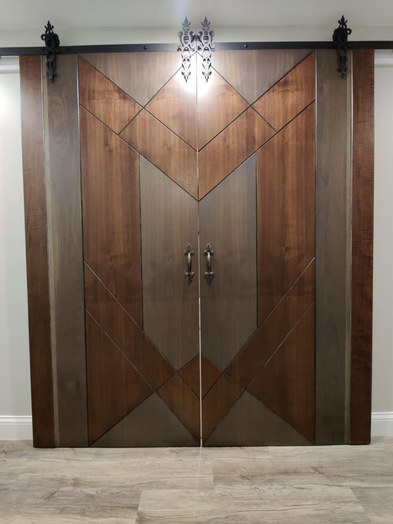 intricate and large wooden door inside a home