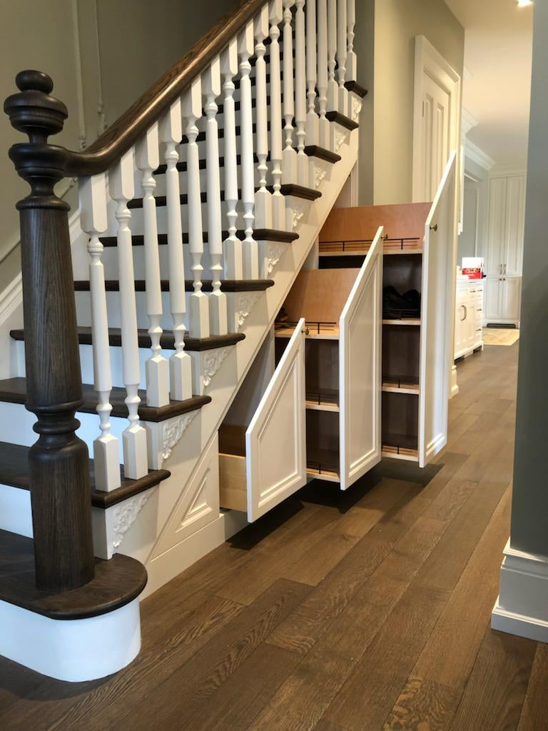 brown and white staircase with three hidden cabinets underneath