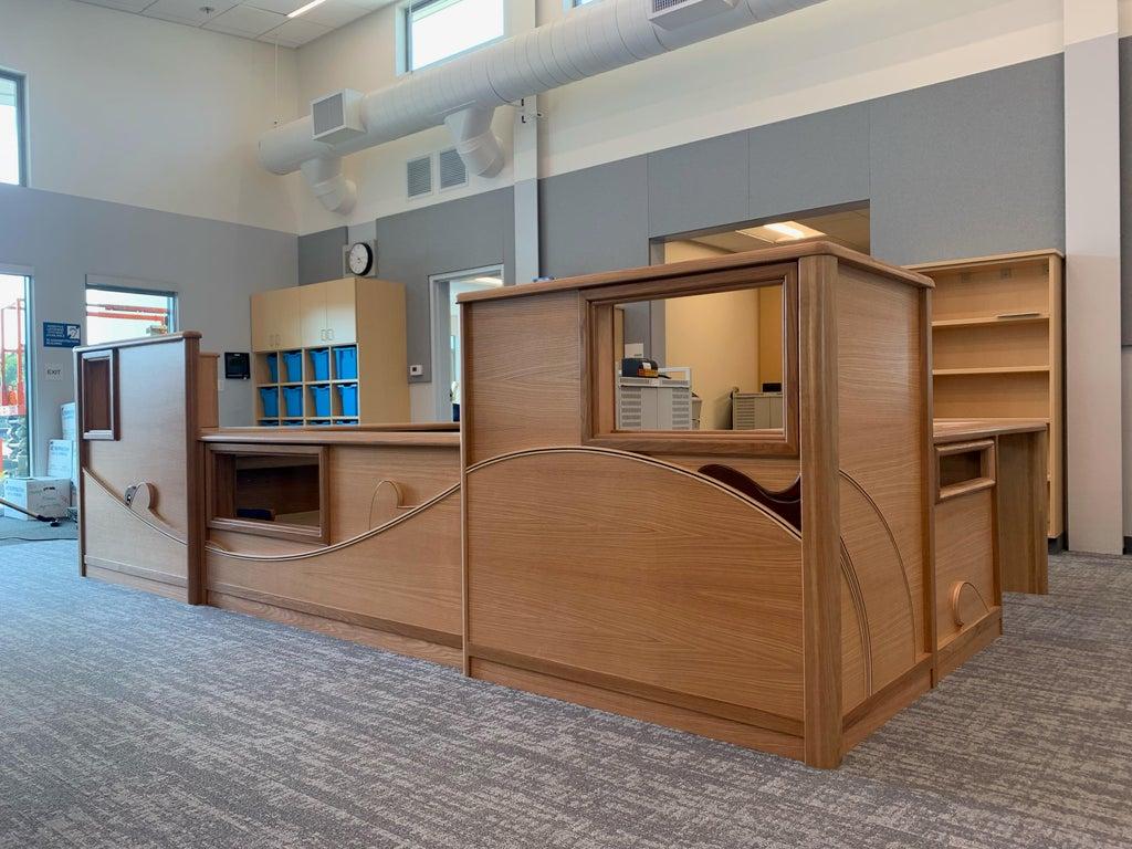 oak desk inside a library