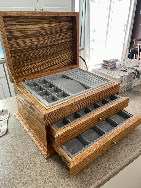 opened up wooden jewelry box