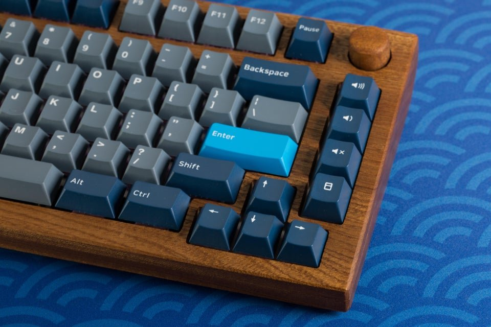 computer keyboard with a wooden background
