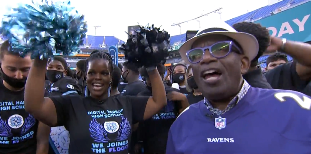 al roker with lots of high school students and a principal with pom poms