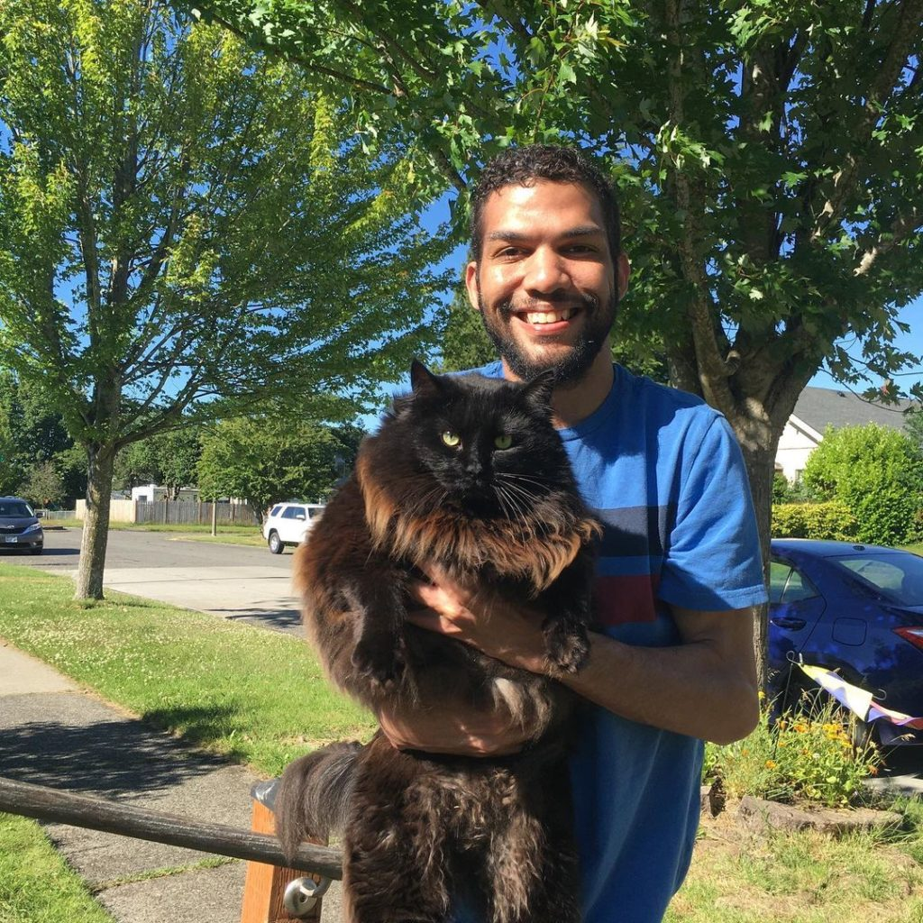 Chris Watson and a black cat