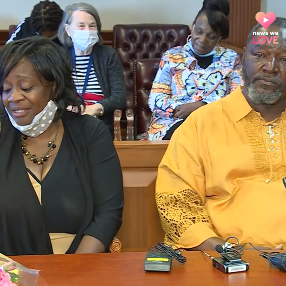 man and woman sitting in court with three people sitting behind them