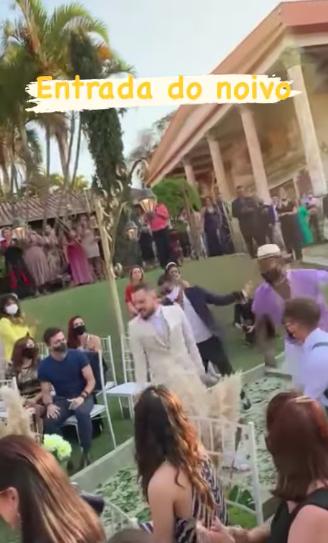 groom dancing down aisle