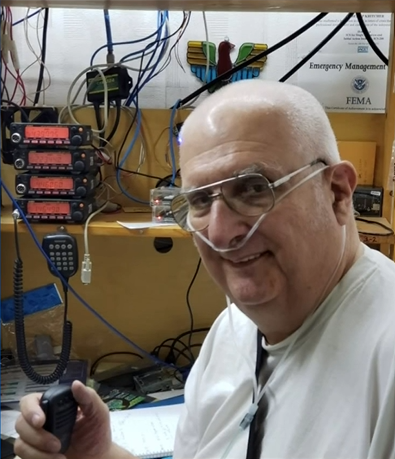 old man wearing a nasal cannula and smiling