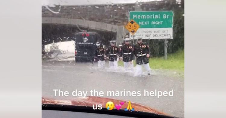 marines wading through flash flood
