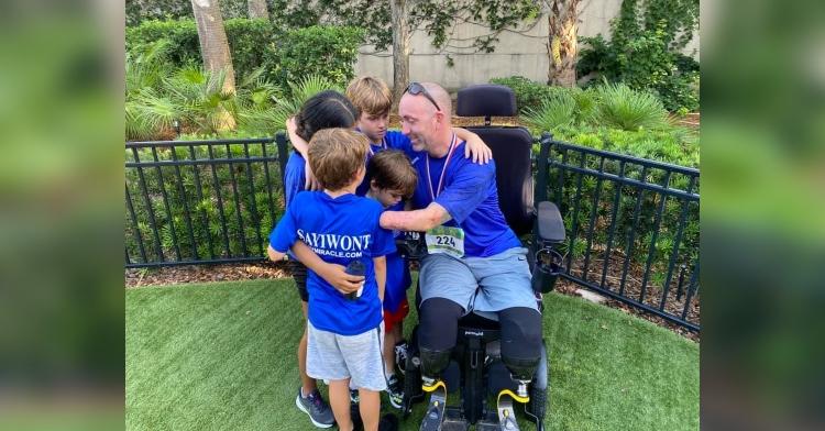 Gary Miracle hugging kids