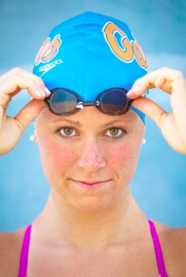 olympian wearing cap and googles on her forehead