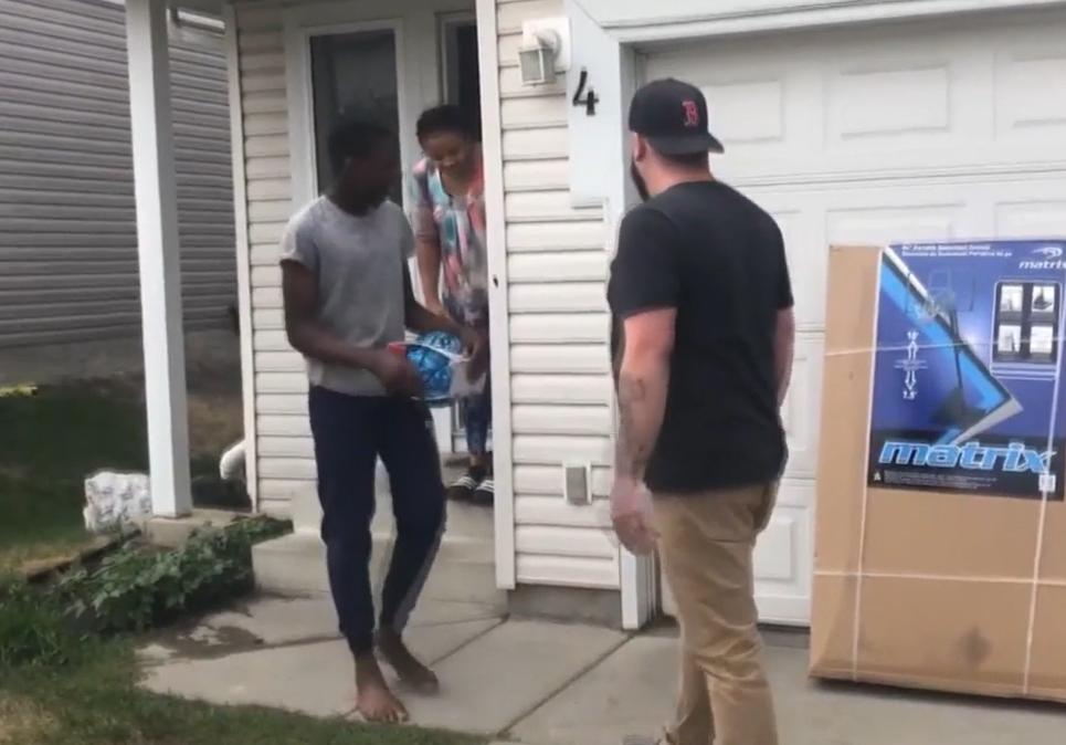 neighbor gives Anthony Muobike basketball net
