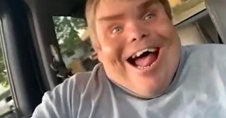 man beaming in response to surprise
